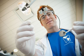 Dentistry student Cameron Garrett looks forward to seeing new and familiar faces. Photo by Martin Dee