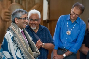 Incoming UBC President Prof. Arvind Gupta, pictured here with Musqueam Elder Shane Pointe (Ti' te-in) and First Nations House of Learning Director, Linc Kesler, was blanketed and given an eagle down ceremonial blessing and welcome at the UBC First Nations Longhouse on July 2, 2014. University of British Columbia, Photo by Martin Dee