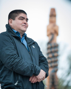 Musqueam artist Brent Sparrow Jr. carved the new Musqueam Post during UBC's Centennial year. Photo credit: Martin Dee